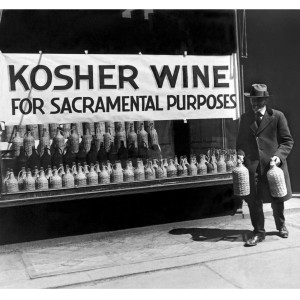 A Jewish man buying kosher wine for sacramental purposes, New York, New York, early to mid 20th century. (Photo by Underwood Archives/Getty Images)